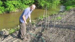 Chris Randall planting on the Seine River